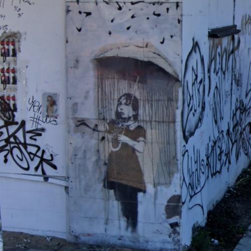 'Umbrella Girl' by Banksy (StreetView)