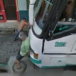 Men pushing a bus
