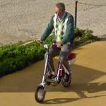 Man on a little bike (StreetView)