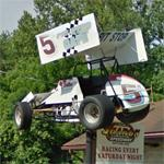 Race car on a sign pole