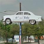 Narrow car on a sign pole (StreetView)