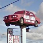 BMW on a sign pole