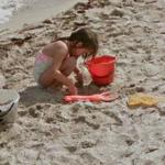 Girl building sandcastle