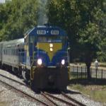 Locomotive accelerating out of train station (StreetView)