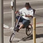 Guy riding a recumbent bicycle (StreetView)