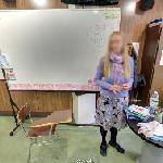 Teacher in class (Euroschools) (StreetView)
