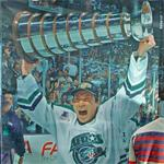 Jim Paek hoisting the Turner Cup (StreetView)