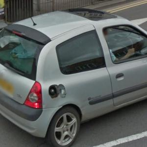 Car driving with open tank cap (StreetView)