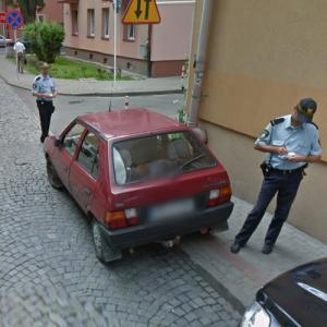 Car getting a parking ticket (StreetView)
