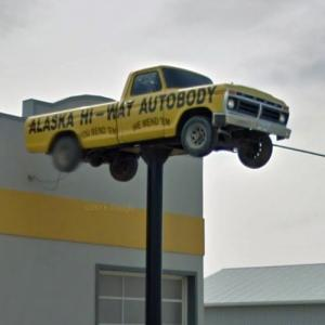 Ford pickup truck on a sign pole (StreetView)