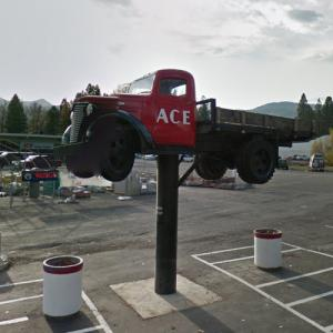 Old Chevy flatbed truck on a pole (StreetView)