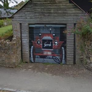 Ford old-timer painting on garage door (StreetView)