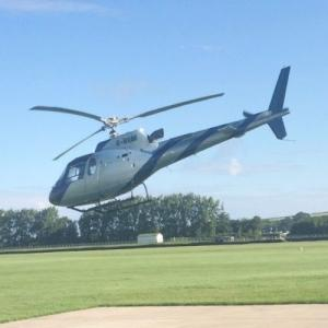 Eurocopter AS-350B-3 Ecureuil in low flight at Goodwood Aerodrome (StreetView)