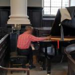 Piano tuner at work