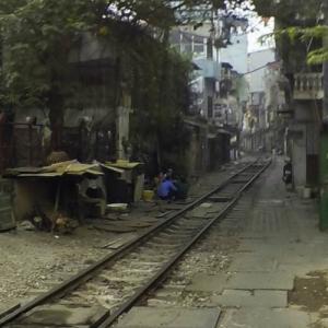 The train in Hanoi driving through narrow housing area (StreetView)