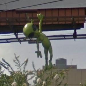 Alien hanging from billboard (StreetView)