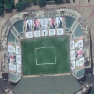 Giant photos of Olympic Presidents on a stadium (Google Maps)