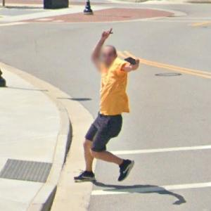 Guy hamming it up (StreetView)