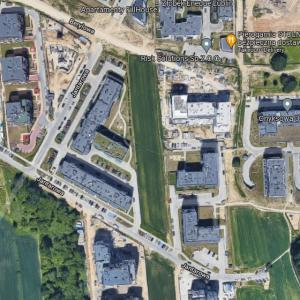 Polish farmer who refused to sell his land to developers and now harvests his field surrounded by apartment blocks (Google Maps)