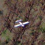 Small aircraft in flight (Google Maps)