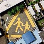 Children crossing huge sign.
