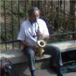 Man playing the saxophone (StreetView)
