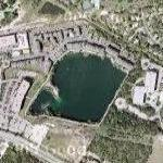 Flooded quarry in urban setting (Google Maps)