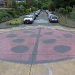 Big ladybug painted in the street (StreetView)