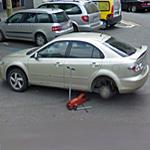 Fixing car in the middle of the street (StreetView)