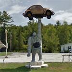 Gorilla holding a VW Beetle (StreetView)
