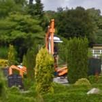 Digging a grave by excavator (StreetView)