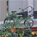Bicycle above Foley's Pub (StreetView)